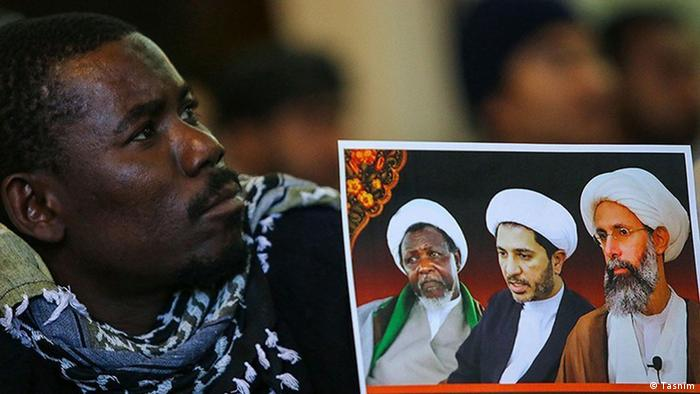A Nigerian protester and a photo showing Nigerian cleric Ibrahim Zakzaky