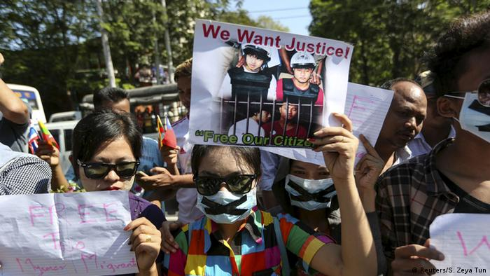 Protesters hold pictures of Zaw Lin and Win Zaw Htun, two Myanmar migrant workers in Thailand, in front of the Thai embassy in Yangon, December 2015 (Reuters/S. Zeya Tun)