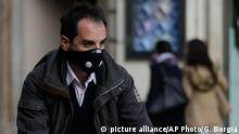 A cyclists wears a protective mask as he pedals in downtown Rome, Thursday, Dec. 24, 2015. Rome and Milan have ordered no-car days to combat pollution, which has hit unhealthy levels for weeks mainly because no rain has fallen to wash away the smog. A six-hour ban on cars on Dec. 28 and Dec. 29 was announced by Rome Thursday, while Milan¿s anti-pollution measure sees six-hour bans those days plus on Dec. 30. (AP Photo/Gregorio Borgia)