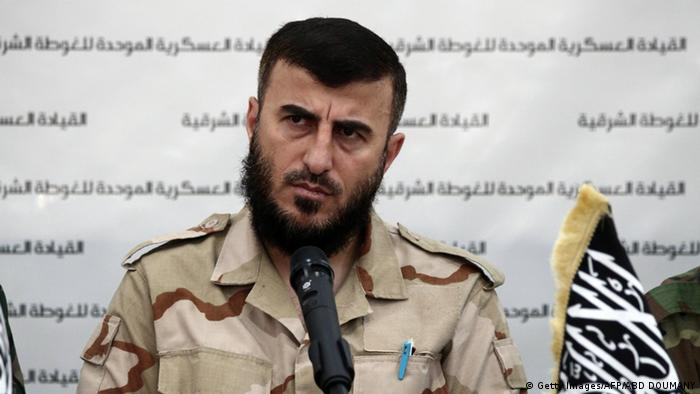 Zahran Allouch, the leader of Jaish al-Islam (Islam Army) and military leader of the Islamic Front, attends a press conference with other brigade leaders in the rebel-held Eastern Ghouta region outside the capital Damascus on August 27, 2014, to announce the fomation of The Unified Military Command of Eastern Ghouta (Photo: ABD DOUMANY/AFP/Getty Images)