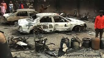 The cahrred remains of a car and its surroundings after a deadly gas Explosion in the Nigerian town of Nnewi