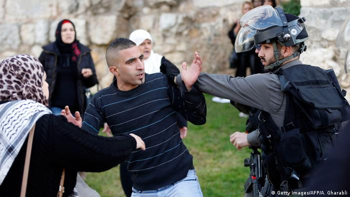 Israeli security forces scuffle with a Palestinian protester outside Damascus Gate in Jerusalem's old city during a demonstration demanding Israeli authorities to return the bodies of alleged Palestinian attackers, on December 26, 2015
