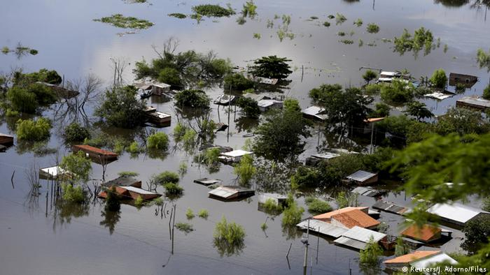 Houses partially submerged in floodwaters in Asuncion, Paraguay, December 20, 2015