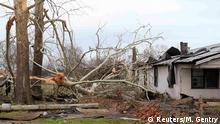 Damage caused by a tornado is seen in a neighborhood in Birmingham, Alabama, December 26, 2015. A tornado struck Birmingham on Friday, damaging houses, uprooting trees and injuring at least three people in the state's largest city, law enforcement and weather officials said. REUTERS/Marvin Gentry Reuters/M. Gentry