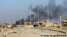 27.12.2015 A picture taken in the early hours on December 27, 2015 shows smoke billowing in Ramadi's Hoz neighbourhood, about 110 kilometers west of the Iraqi capital Baghdad, during military operations conducted by Iraqi pro-government forces against the Islamic State (IS) jihadist group. Iraq's elite counter-terrorism service (CTS) and the army have advanced steadily through the devastated capital of Anbar province clearing the Hoz neighbourhood in central Ramadi completely, according to spokesman Sabah al-Numan. AFP PHOTO / STR / AFP / STR (Photo credit should read STR/AFP/Getty Images) Getty Images/AFP/STR