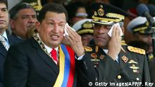 Venezuela's President Hugo Chavez (L) and Defense Minister Raul Isaias Baduel, wipe their sweat during a military parade in honour of the inauguration of Chavez, in Caracas, 10 Janary, 2007. Chavez, a harsh critic of the United States, was sworn for a new six-year term, promising to implement socialism Venezuelan-style. I swear on this marvelous constitution, on Christ, the greatest socialist in history, I will not let my arms nor my soul rest. I will dedicate my life and my nights to building Venezuelan socialism, said Chavez. The President paraphrased Argentine-born Cuban revolutionary hero Ernesto Che Guevara, proclaiming Fatherland, socialism or death! Chavez, in power since 1999, has pursued populist and social programs making literacy and health care top priorities. AFP PHOTO/Pedro REY (Photo credit should read PEDRO REY/AFP/Getty Images) Getty Images/AFP/P. Rey