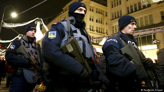Austrian armed police officers walk on the streets of downtown Vienna (Reuters/L.Foeger)