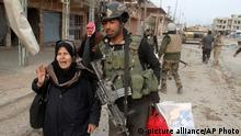 1.1.2016 *** Iraqi security forces help trapped civilians to come out to safe places in Ramadi, 70 miles (115 kilometers) west of Baghdad, Iraq, Thursday, Dec. 31, 2015. Anbar Provincial Council head Sabah Karhout told The Associated Press on Thursday that sporadic clashes and airstrikes were taking place in areas that are still under IS control. He says a major offensive to clear the remainder of the provincial capital is on hold due to the bad weather, he says families are still trapped in the IS-held areas of the city, where they are being used as human shields. (AP Photo) picture alliance/AP Photo