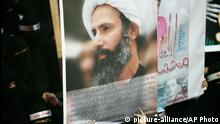 ARCHIV 2012 *** FILE - In this Sunday, Sept. 30, 2012 file photo, a Saudi anti-government protester carries a poster with the image of jailed Shiite cleric Sheik Nimr al-Nimr during the funeral of three Shiite Muslims allegedly killed by Saudi security forces in the eastern town of al-Awamiya, Saudi Arabia. The brother of al-Nimr said Sunday, Oct. 25, 2015, that a death sentence against the religious leader has been upheld on appeal. Al-Nimr is a vocal critic of the government and was a central figure in 2011 Shiite protests that erupted as part of the Arab Spring. He was found guilty of sedition and other charges and sentenced to death in October last year. (AP Photo, File) © picture-alliance/AP Photo