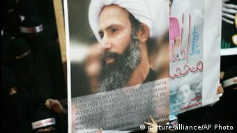 A poster showing the face of Nimr al-Nimr