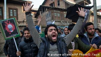 A Kashmiri Shiite Muslim man shouts slogans against the execution of Sheikh Nimr al-Nimr, during a protest in Srinagar, Indian controlled Kashmir, Saturday, Jan. 2, 2016