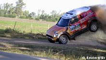2.1.2016 Guo Meiling of China jumps her Mini into the road during the 38th Dakar Rally in Arrecifes, Argentina, January 2, 2016. REUTERS/Stringer EDITORIAL USE ONLY. NO RESALES. NO ARCHIVE. Reuters/Str