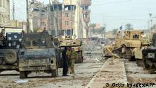 Iraqi pro-government forces battle Islamic State (IS) group jihadists as they try to secure all the neighbourhoods of Ramadi, the capital of Iraq's Anbar province, about 110 kilometers west of the capital Baghdad, on January 1, 2016. Iraq declared the city of Ramadi liberated from the Islamic State group on December 28 and raised the national flag over its government complex after clinching a landmark victory against the jihadists. AFP PHOTO / STR / AFP / STR (Photo credit should read STR/AFP/Getty Images) Getty Images/AFP