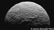 This photo from a sequence of images provided by NASA, taken from the Dawn spacecraft of Ceres, a dwarf planet located in the asteroid belt between Mars and Jupiter. NASA said the start of science observations was slightly delayed because of a communication glitch. The space agency said the delay won¿t affect the overall mission. (NASA via AP) picture alliance / AP Photo
