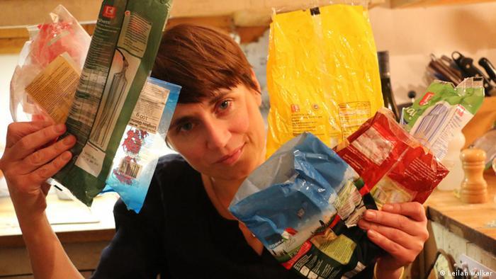 Tamsin Walker holding empty plastic food bags
