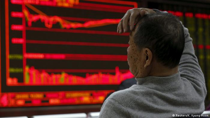 Man looking at board with stock information