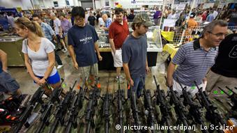 People shopping for guns