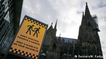 An electronic information sign warning the general public against pickpockets, is displayed on an advertising board outside the main railway station and in front of Cologne Cathedral in Cologne, Germany, January 5, 2016.