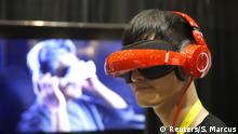 January 4, 2016 Eric Yu of Royole models the company's foldable Smart Mobile Theater system during CES Unveiled, a preview event of the 2016 International CES trade show, inlass=highlight> Las lass=highlight>Vegas, Nevada January 4, 2016. The $700.00 system has noise-canceling headphones and a viewing system that is vision correctable so you don't need to wear your glasses, Yu said. REUTERS/Steve Marcus (c) Reuters/S. Marcus