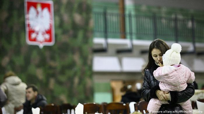 Ukrainians fleeing from the conflict in their country arrive in Poland
