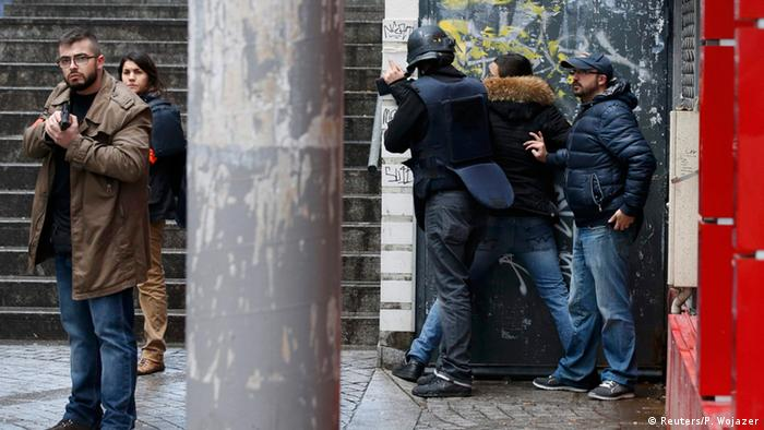 Police frisk a man