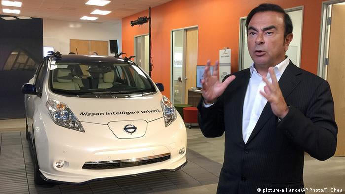 Carlos Ghosn, chairman and CEO of Nissan, speaks next to a prototype of the autonomous driving Nissan Leaf at Renault-Nissan Silicon Valley in Sunnyvale, Calif
