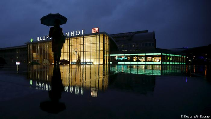 A woman walks in front of the main railway station in Cologne © Reuters/W. Rattay