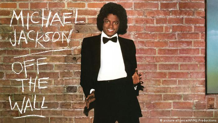 Michael Jackson Off the Wall album will him wearing a tuxedo standing in front of a brick wall.