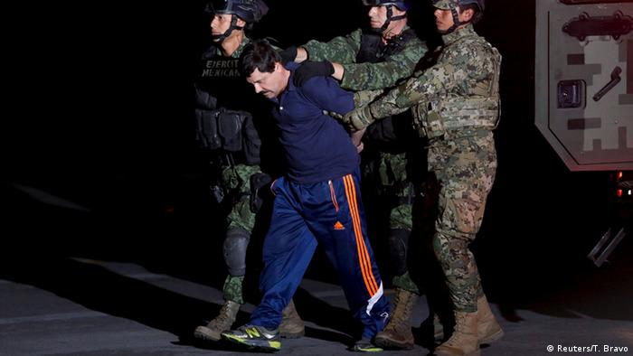 Police escort El Chapo across an airport