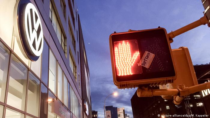 The logo of Volkswagen next to a red traffic light for pedestrians in New York
