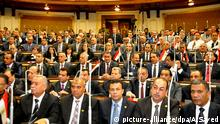 Jan. 10, 2016 - Cairo, Cairo, Egypt - Staff members attend the swearing-in session of the Parliament during the first meeting of Egypt's newly elected parliament, inside the People's Assembly for the opening session of the new parliament in Cairo, Egypt, on Jan. 10, 2016 picture-alliance/dpa/A.Sayed