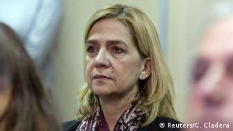 Spanish Princess Cristina sits in a courtroom during the first day of her corruption trial.