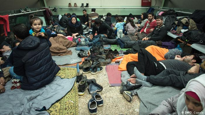 Afghan families take shelter in the central bus station in Chios