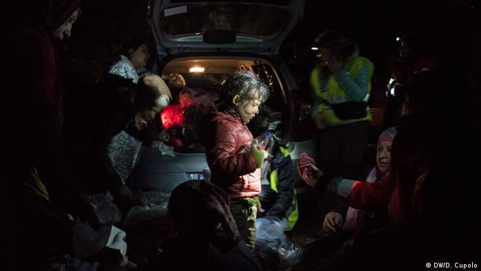 A Syrian girl receives dry clothes after landing in Chios on Friday night