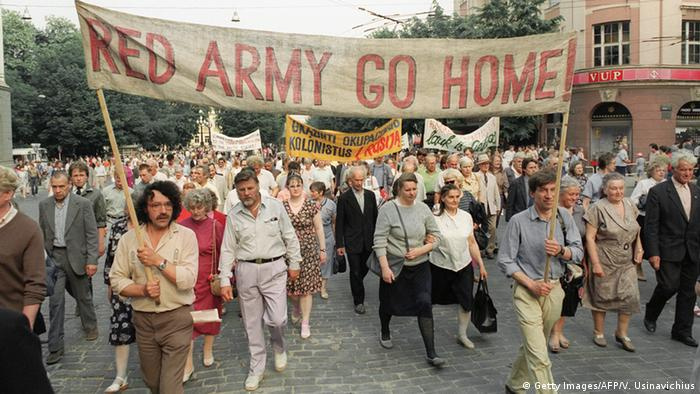 Pro-democracy supporters carry a banner reading 'Red Army Go Home' in Vilnius, Lithuania, in March 1991