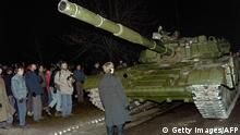 A Lithuanian demonstrator stands in front of a Soviet tank on January 13, 1991, in Vilnius (Getty Images/AFP)
