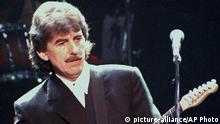 FILE - In this April 6, 1995 file photo, former Beatle guitarist George Harrison performs at a concert in London. Harrison, along with John Mellencamp, Marvin Gaye, Jimi Hendrix, Madonna and Tom Petty, are among the A-list contenders nominated for the 2016 Songwriters Hall of Fame. The 2016 Songwriters Hall of Fame Annual Induction and Awards Gala will take place June 9, 2016. (AP Photo, file)