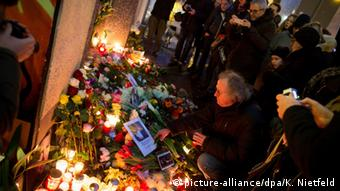David Bowie fans lay flowers at Hauptstrasse 155 where the musician once lived.