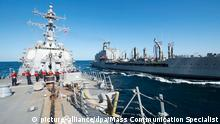 In this Thursday, Dec. 24, 2015 photo released by the U.S. Navy, guided-missile destroyer USS Bulkeley participates in a replenishment-at-sea with fleet replenishment oiler USNS John Lenthall in the Gulf of Oman. Iranian naval vessels conducted rocket tests last week near the USS Harry S. Truman aircraft carrier, the USS Bulkeley destroyer and a French frigate, the FS Provence, and commercial traffic passing through the Strait of Hormuz, the American military said Wednesday, Dec. 30, 2015 causing new tension between the two nations after a landmark nuclear deal. (Mass Communication Specialist 2nd Class M. J. Lieberknecht/ U.S. Navy via AP) MANDATORY CREDIT picture-alliance/dpa/Mass Communication Specialist