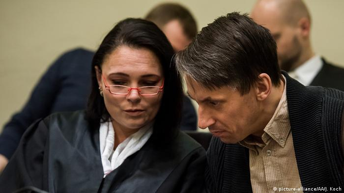 Co-defendant Ralf Wohlleben confers with his lawyer in court