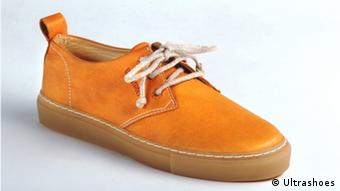 A tan shoe with a white lace