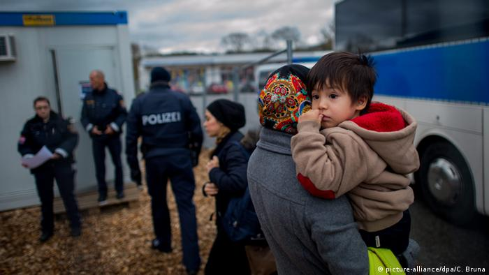 Migrants arrive at a temporary camp after German officials sent them back to Austria in Schaerding Am Inn