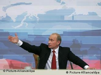 Russian President Vladimir Putin in front of a map of Russia
