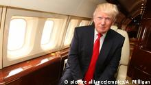 Donald Trump comments on Muslim. File photo dated 15/5/2014 of American tycoon Donald Trump onboard his private jet. More than 360,000 people have backed a call for Donald Trump to be banned from the UK after he suggested Muslims should be barred from America. Issue date: Thursday December 10, 2015. Thousands rushed to sign a petition on the Parliament website as British politicians lined up to condemn the remarks. The property tycoon and reality TV star, who is seeking the Republican nomination for next year's presidential election, provoked widespread anger and ridicule after demanding a block on Muslims entering the US and claiming parts of London were so radicalised that police were afraid for their own lives. See PA story POLITICS Trump. Photo credit should read: Andrew Milligan/PA Wire URN:24997613 Copyright: picture alliance/empics/A. Milligan