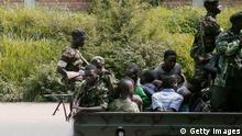 A military vehicle, carrying men tied up, drives through the Musaga neighbourhood of the city of Bujumbura on December 11, 2015. Heavily-armed gunmen launched coordinated assaults on three army barracks in the Burundian capital on December 11 leaving at least a dozen dead in the worst unrest since a failed May coup. / AFP / STRINGER (Photo credit should read STRINGER/AFP/Getty Images) +++ (C) Getty Images