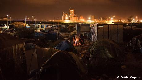 A night time view of the camp, containers in the background