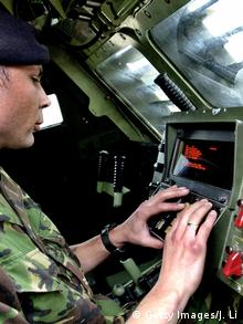 A soldier at the controls of the US M270 missile launcher