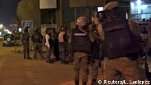 16.01.2016 *** Burkinabe and French soldiers stand near the Splendid Hotel in Ouagadougou, Burkina Faso, January 15, 2016, where suspected Islamist fighters are holding hostages. REUTERS/Ludivine Laniepce EDITORIAL USE ONLY. NO RESALES. NO ARCHIVE. TPX IMAGES OF THE DAY © Reuters/L. Laniepce