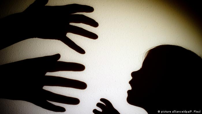 Hands reaching towards a child