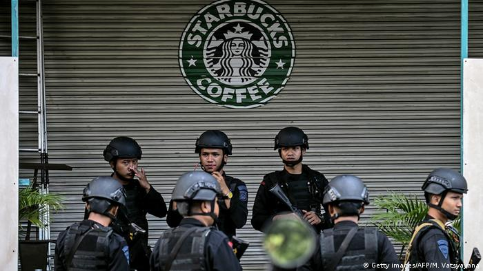 Indonesian police stand guard in front a Starbucks in Jakarta, site of last week's terror attack.